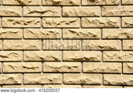 Close-up Beige Brick Wall With Copy Space. Grunge Brick Wall Background. Beige Brick Wall For Textur
