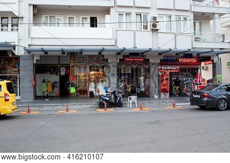 View Of The Shopping Tourist Street. Street Cafe And Restaurant. Bored Sellers Souvenir In Tourist S