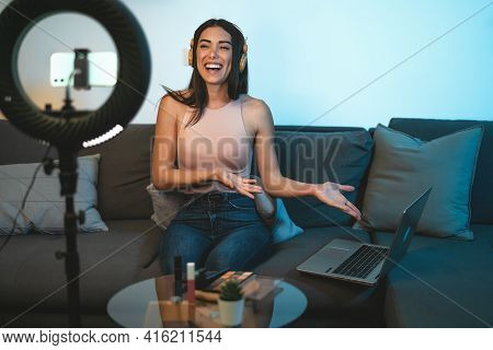 Female Influencer Vlogging Online With Smartphone Cam And Laptop From Home - Youth People With Socia