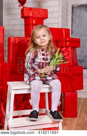 Laughing Girl Holds A Bouquet Of Tulips. Natural Beauty. Young Blond Girl Celebrating Her Birthday A