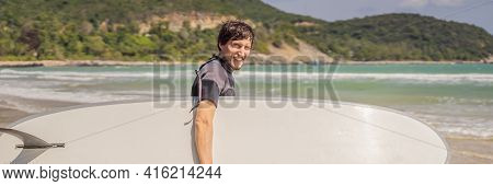 Banner, Long Format Young Surfer Standing Agains The Ocean Looking The Waves, Professional Surfer In