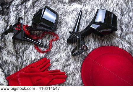 Flat Lay Collage With Woman's Black High-heeled Shoes, Red Hat And Gloves On Wolf Fur Background. Fe