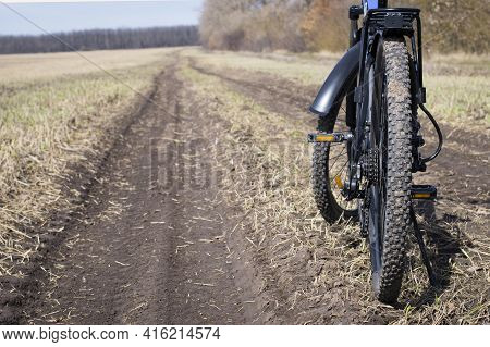 Rear Wheel Of A Mountain Bike. Mountain Bike. Stands On A Field Road. Concept Of Cycling, Repair Or