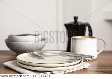 Set Of Clean Dishware On Wooden Table, Space For Text