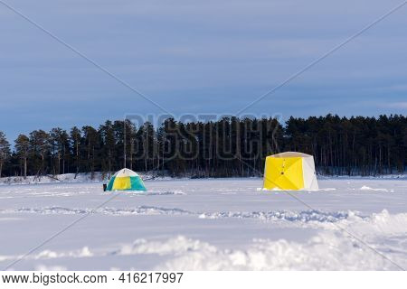 Tent On Ice Fishing Of Winter. Landscape Winter. Ice Fishing Is Popular Sports For Canada