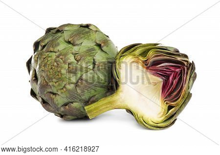 Cut And Whole Fresh Artichokes On White Background