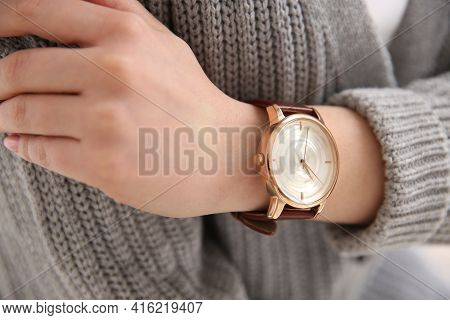 Woman In Casual Sweater With Luxury Wristwatch, Closeup