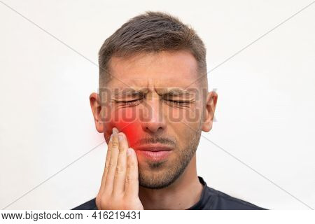 Man Touching His Cheek Because Of Strong Tooth Pain. Man Suffering From Toothache, Dental Illness Or