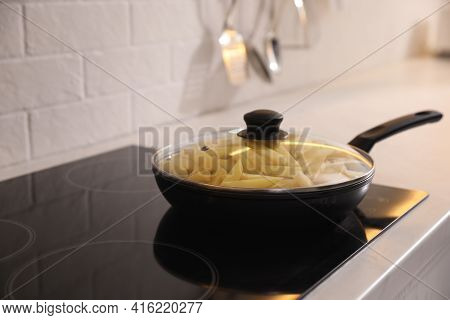 Frying Pan With Cut Raw Potatoes On Cooktop, Space For Text