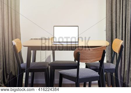 Laptop On Empty Wooden Table Inside Of House