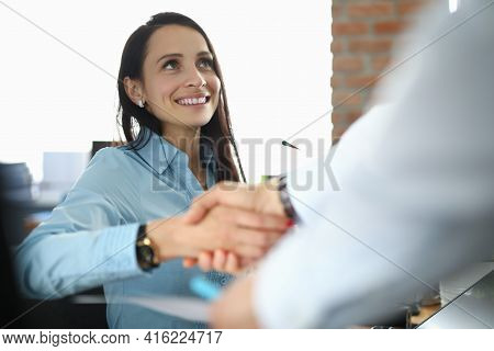 Businesswoman Shaking Hands With Partner Man In Office