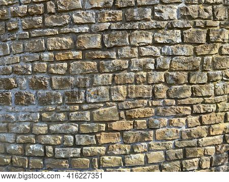 Horizontal part of Old yellow brick wall with devastating bricks, Belgian Ardennes, Belgium, Torgny