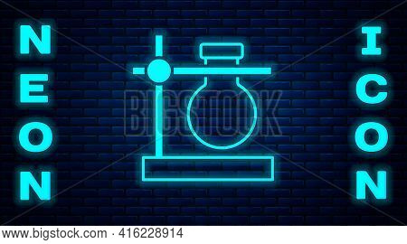 Glowing Neon Glass Test Tube Flask On Stand Icon Isolated On Brick Wall Background. Laboratory Equip
