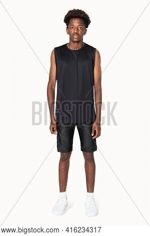African American boy in black tank top and shorts sportswear apparel shoot