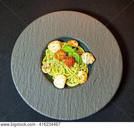 Fried Saltwater Seashells On Spaghetti With Green Pesto