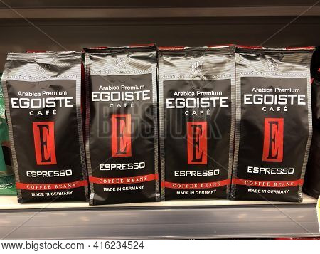 Egoiste Arabica Premium Espresso Ground Cafe, Row Of Coffee In Plastic Bags Packing In A Supermarket