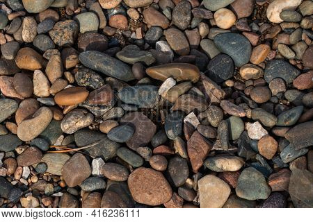 Colorful Colorful River Pebbles, Natural Background, Texture. Close-up Texture Of Colorful Sea Pebbl
