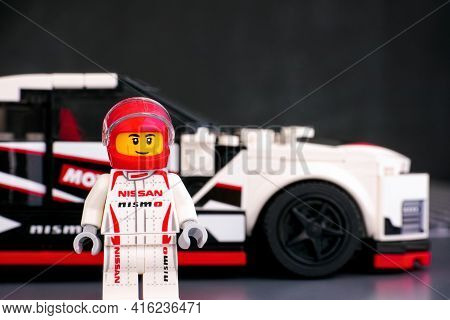 Tambov, Russian Federation - June 25, 2020 Lego Nissan Gt-r Nismo Driver Minifigure Against His Car