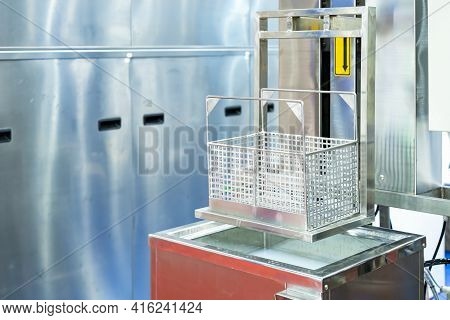 Close Up Empty Stainless Basket Of Ultrasonic Cleaning Machine On Water Tank Or Solution Bath For Re