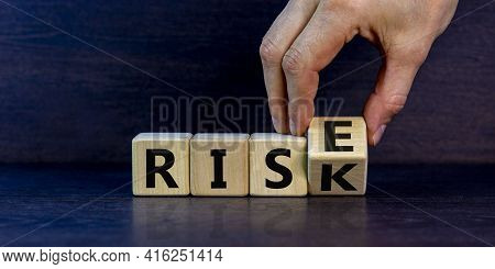 Risk Vs Rise Symbol. Businessman Turns A Wooden Cube And Changes The Word Risk To Rise. Beautiful Gr