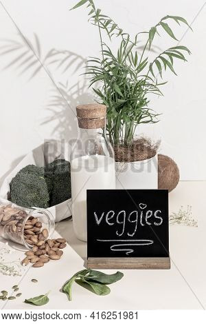 Composition With Healthy, Vegan Food On A Eco Friendly Kitchen. Natural Organic Vegetables, Almond,