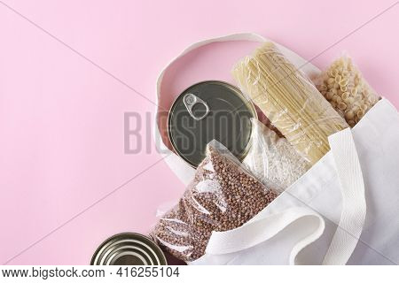 Textile Grocery Bag With Food Supplies Crisis Food Stock For Quarantine Isolation Period On Pink Bac