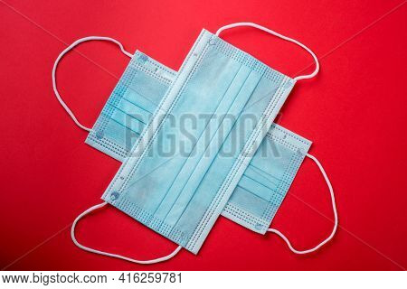 Surgical Mask With Rubber Ear Straps. Typical 3-ply Surgical Mask To Cover The Mouth And Nose. Proce