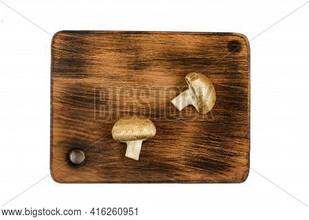 Raw Mushroom Champignon Cut Into Halves On A Wooden Board. Cooking Fresh Champignons. Top View