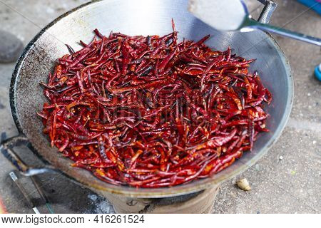 Roasted Dried Chili In The Pan To Produce Cayenne Pepper Of Thai People