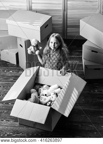 Happy Child Cardboard Box. Happy Little Girl Sit In Room On Boxes. Purchase Of New Habitation. Repai