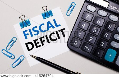 On A Light Background, A Calculator, A Pen, Blue Paper Clips And A Sheet Of Paper With The Text Fisc