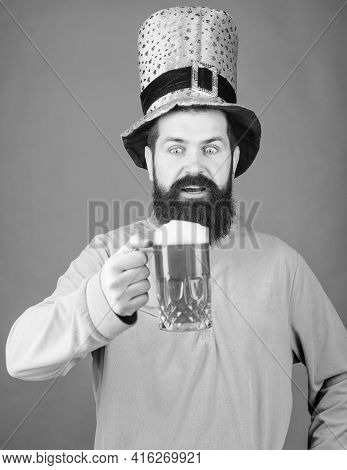 Man Brutal Bearded Hipster Drink Pint Beer. Irish Pub. Drinking Beer Part Celebration. Bar Seasonal