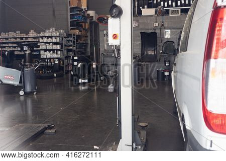 LliÇÀ D'amunt, Spain - 14 March 2021 - Inside Of A Car Workshop. Changing Tires Of Cars And Repairin
