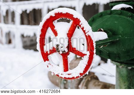 Red Gate Valve In The Snow. Shut-off And Control Valves