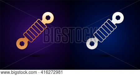 Gold And Silver Shock Absorber Icon Isolated On Black Background. Vector