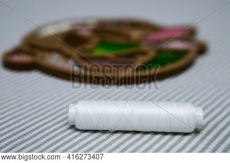 Weaving From Beads. A Box With Beads And A Skein Of Thread. Selective Focus.