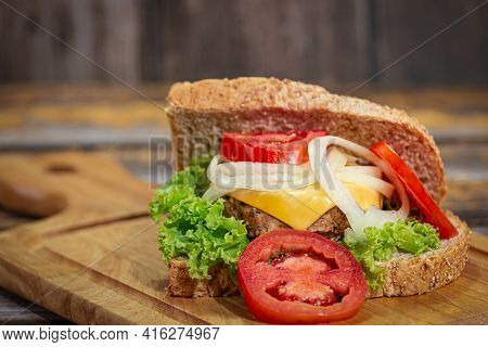 Sandwich Bread With Cheese, Ham, Tomato, Salad, Onion Isolated On White Background. Top View., Close