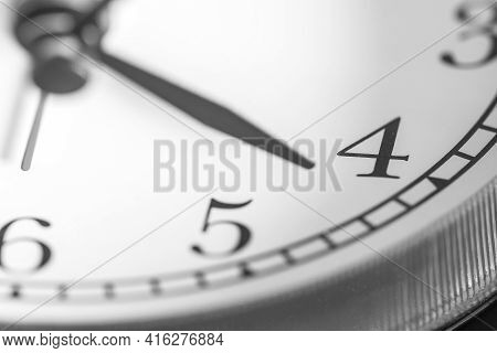 Clock Hand Pointing Four O'clock On White Clock Face Of Twin Bell Classic Alarm Clock
