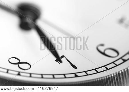 Clock Hand Pointing Seven O'clock On White Clock Face Of Twin Bell Classic Alarm Clock
