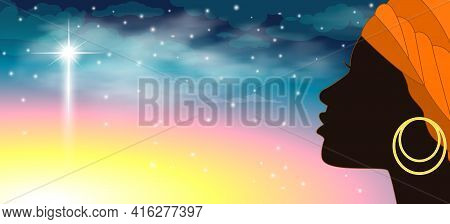 Silhouette Of A Young African Woman Against The Background Of The Starry Sky And One Large Shining S