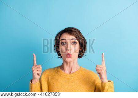 Photo Portrait Of Surprised Girl With Bob Hairstyle Pointing Up At Copyspace With Fingers Staring Is