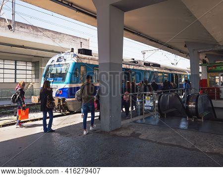 Thessaloniki, Greece - April 09 2021: Passengers Waiting To Board A Train Coach. Unidentified Crowd