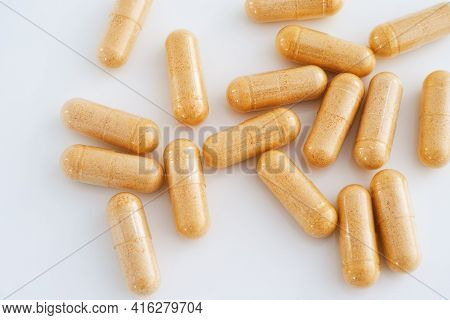 Vitamin B Complex Capsules On A Table. Close Up