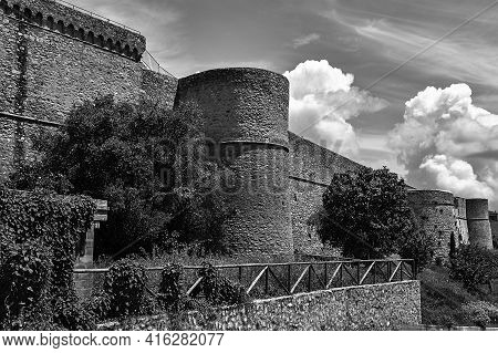 Medieval Stone Fortified Walls And Towers In Magliano In Tuscany, Italy, Monochrome