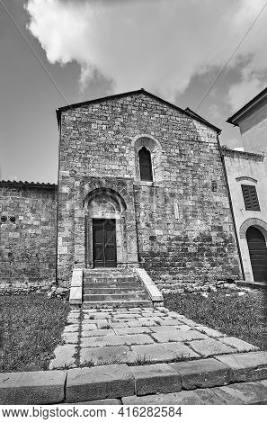 Stone Facade Of A Historic House In The Town Of Magliano In Toscana, Italy, Monochrome