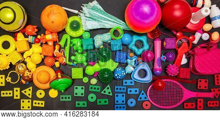 Many Colorful Toys Collection On The Black Background