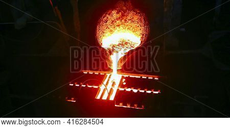 Casting Steel At A Steel Plant. Molten Metal Was Poured From The Ladle. Metallurgical Production, He
