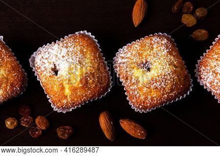 Mini muffins on dark brown background. Selective focus.