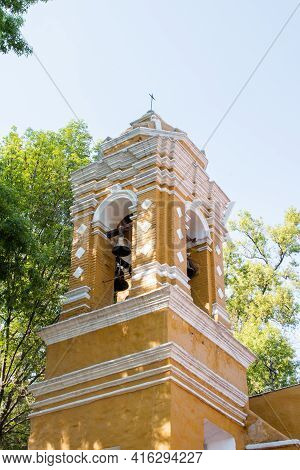 Belltower From Old Mexican Church Surrounded By Trees