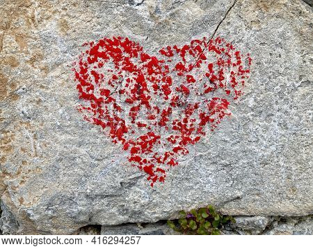 Red Heart Shape Painted On A Rock Stone In Lugano, Switzerland